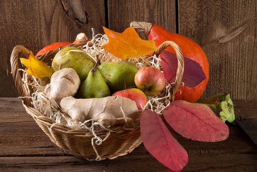 Screensaver autumn leaves, autumn composition of vegetables and fruits on the monitor