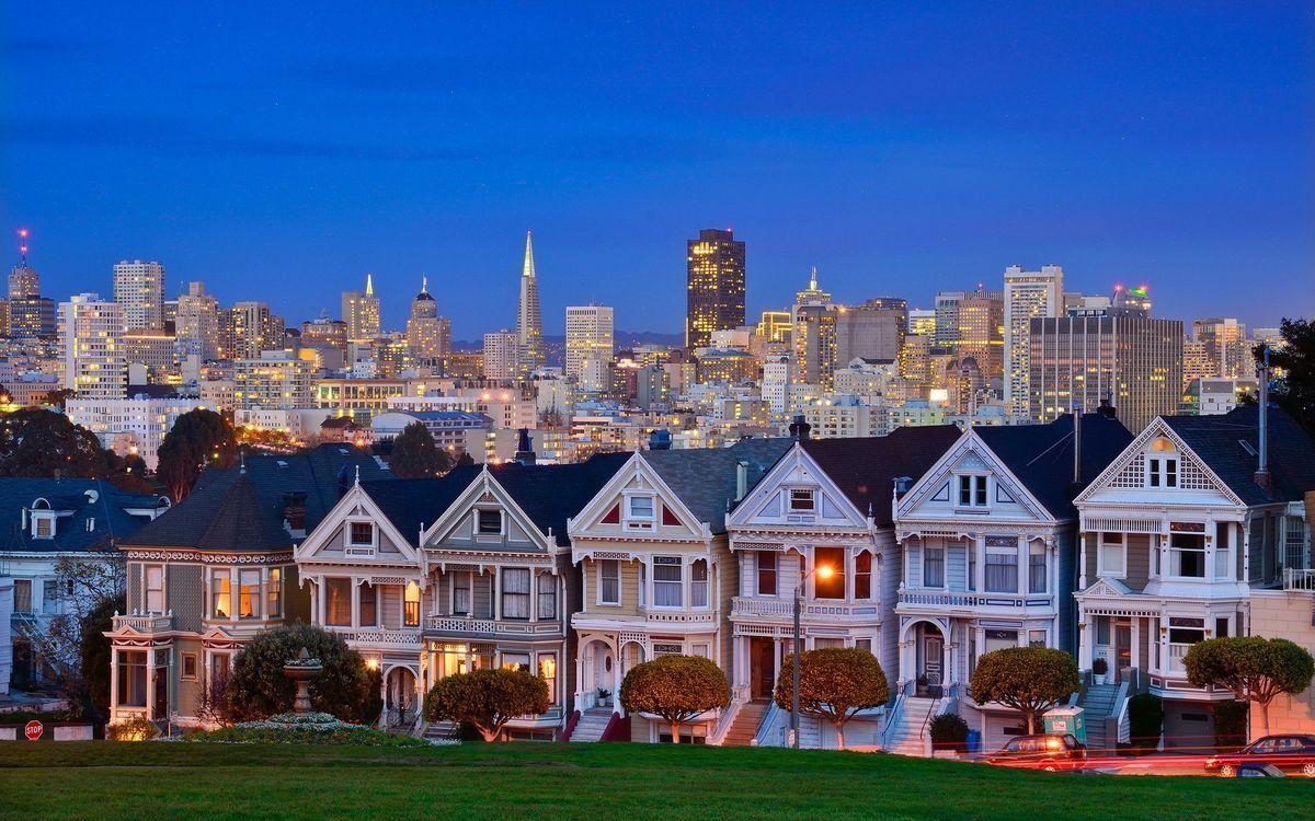 Фото бесплатно вечер, дома, высотки, улицы, машины, огни, город