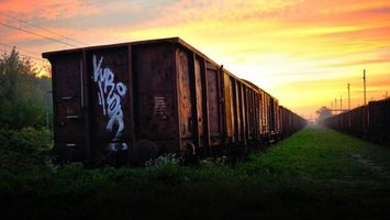 Бесплатные фото железная дорога,вагоны,грузовые,трава,деревья,небо