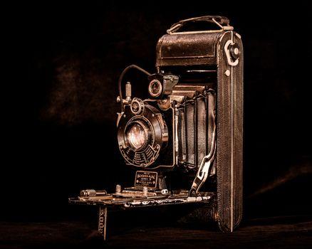 Фото бесплатно фотоаппарат, камера, чёрный фон