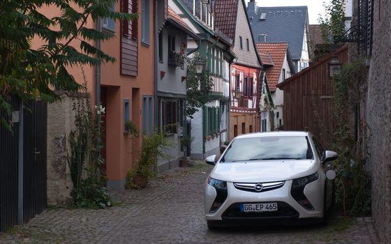 Бесплатные фото Электромобиль,Опель,Ампера,Opel,Ampera,зарядка,технологии,Германия,дома,улица