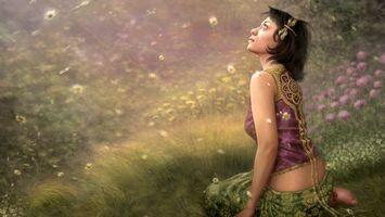 Бесплатные фото девуска,сидит,взгляд,вверх,трава,цветы,природа