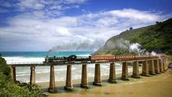 Бесплатные фото паровоз,дым,вагоны,мост,берег,море,разное