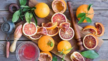 Фото бесплатно фрукты, апельсин, листья, зеленые, доска, стол, еда