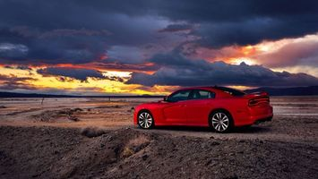 Фото бесплатно тачка, красная, диски, вечер, небо, тучи, машины