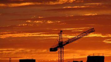 Бесплатные фото кран,закат,небо,тучи,здание,постройки,город