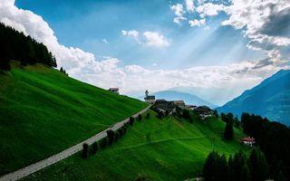 Заставки горы,косогор,дома,поселение,дорога,деревья,небо