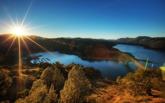 Бесплатные фото солнце,восход,река,деревья,холмы,полуостров,мост,дорога,пейзажи,природа