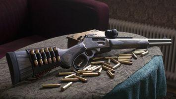 Бесплатные фото винтовка,карабин,пули,патроны,стол,диван,оружие