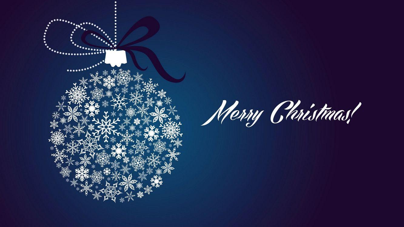 Фото бесплатно игрушка, круглая, рождество, надпись, вектор, снежинки, синий фон, новый год, праздники, праздники