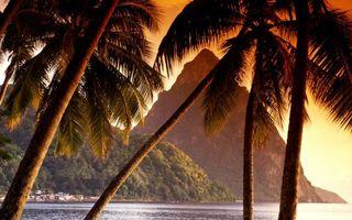 Заставки острова,горы,строения,скалы,пальмы,море