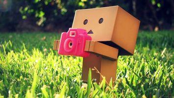 Фото бесплатно робот, коробки, фотоаппарат