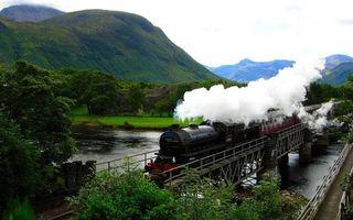 Обои поезд, рельсы, шпалы, пар, горы, холмы, деревья, река, вода, природа