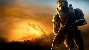 Бесплатные фото солдат,шлем,оружие,автомат,закат,небо,тучи