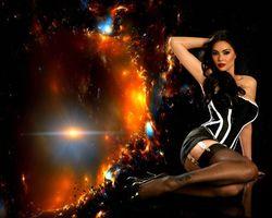 Бесплатные фото tera patrick,девушка,брюнетка,сидит,на,фоне,космоса