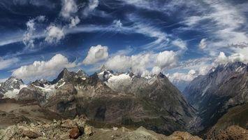 Бесплатные фото горы,камни,вершины,снег,ущелье,небо,облака