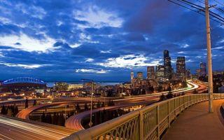 Обои небо, тучи, мост, эстакада, дорога, асфальт, дома, провода, столбы, вечер, огни, город