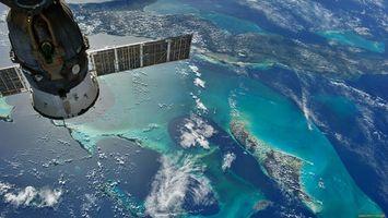 Бесплатные фото спутник,крылья,планета,вода,земля,облака,космос