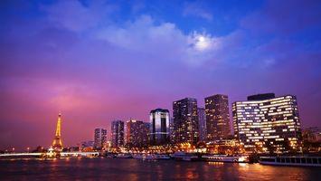 Обои франция, париж, эйфелева башня, небоскребы, вечер, небо, облака, город