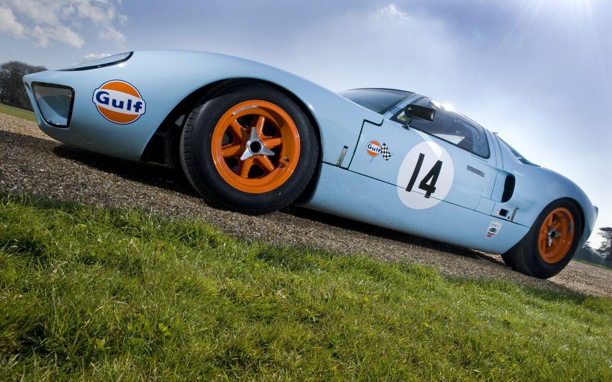 Фото бесплатно тачка, голубая, спорт, диски, оранжевые, трава, машины, машины