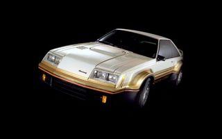 Фото бесплатно автомобиль, золотой, черный фон