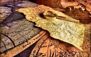 Фото бесплатно древние карты, папирус, позолоченная лупа