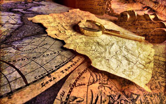 Photo free ancient maps, papyrus, gilt magnifier