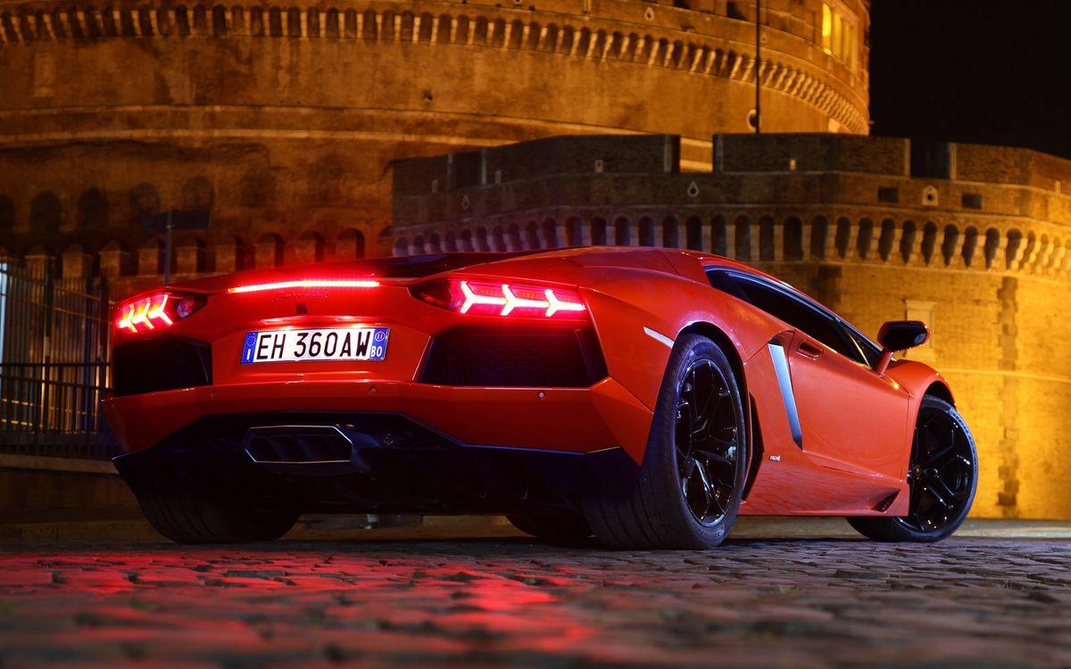 Фото бесплатно lamborghini, aventador, lp700-4, автомобиль, оранжевый, колеса, фары, здание, машины, машины