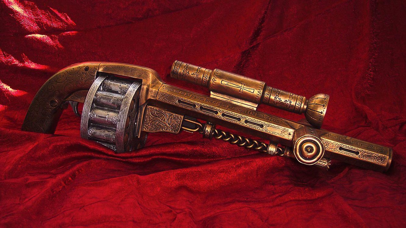 Фото бесплатно револьвер, пистолет, пули, гравировка, надпись, красный, ручная работа, крест, рисунок, прицел, курок, оружие, оружие