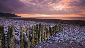 Фото бесплатно пляж, забор. бревна, камни