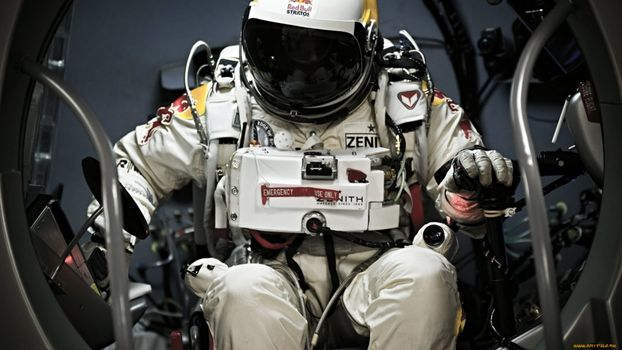 Photo free cosmonaut, space suit, sits