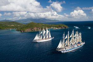 Обои корабли, яхты, паруса, соре, океан, вода, волны, остров, деревья, небо, облака, высота