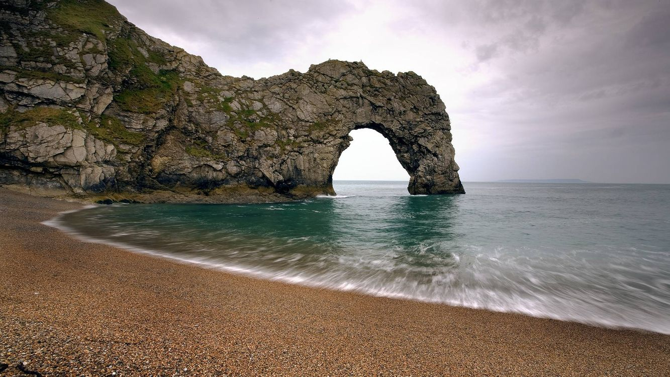 Фото бесплатно море, берег, песок, скала, камни, арка, природа