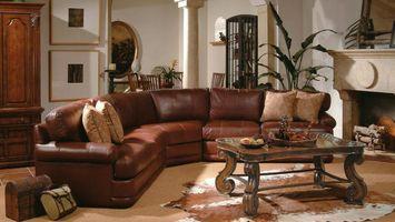 Бесплатные фото гостиная,диван,кожаный,стол,камин,подушки,интерьер