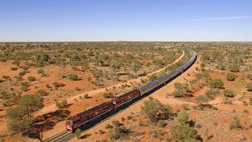 Бесплатные фото ghan train,песок,кусты,деревья,поезд,небо,голубое