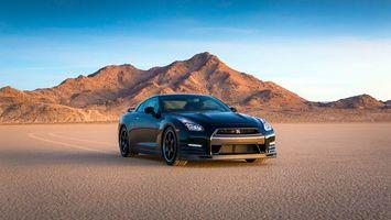 Заставки ниссан гтр, спорткар, пустыня, песок, небо, диски, бампер, следы, отражение, шины, машины