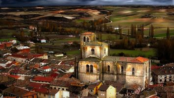 Бесплатные фото дома,крыши,деревья,поле,небо,тучи,город