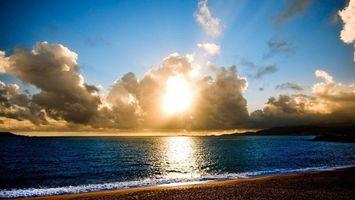 Фото бесплатно берег, песок, море, горизонт, небо, солнце, облака