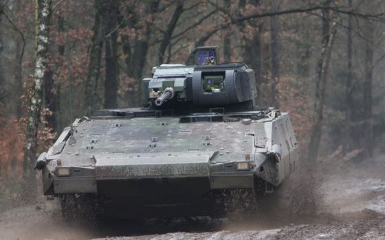 Photo free armored personnel carrier, caterpillars, mud