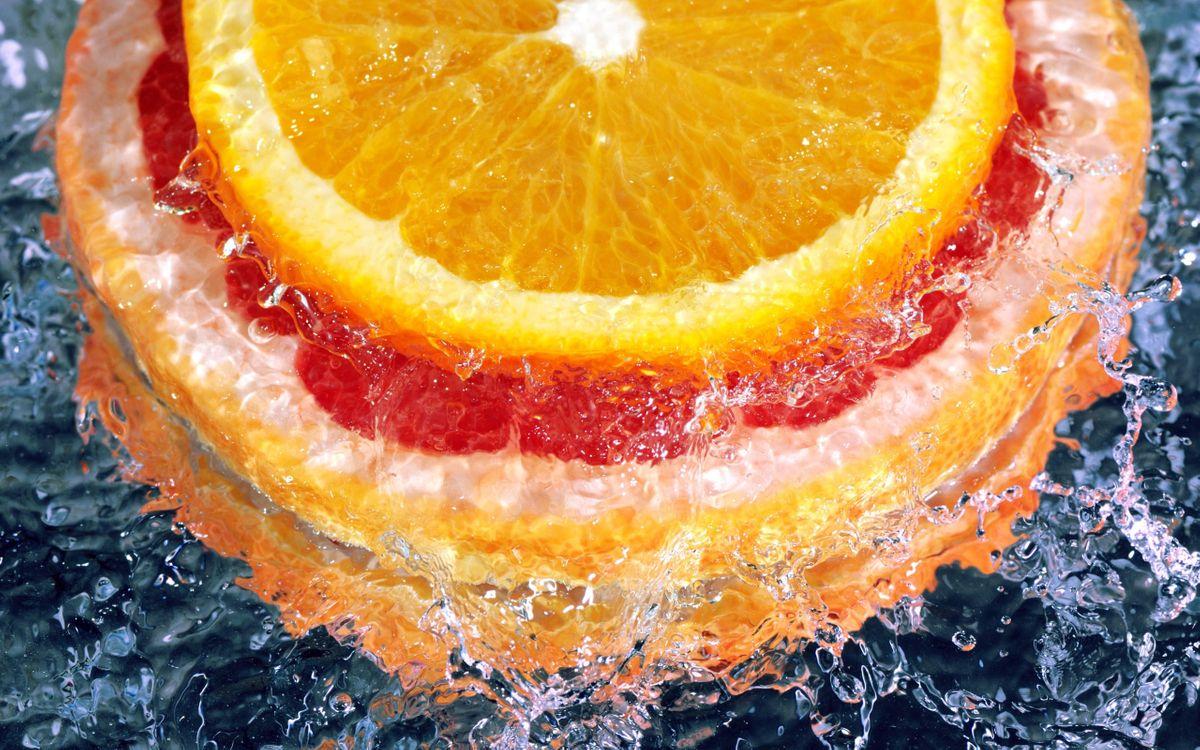 Фото бесплатно апельсин, грейпфрут, цитрусовые, фрукты, дольки, вода, брызги, сок, кружочки, капли, еда, еда