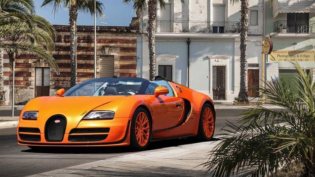 Фото бесплатно бугатти, вейрон, кабриолет, оранжевый, диски, улица, дорога, машины