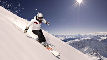 Photo free skier, skis, mountains