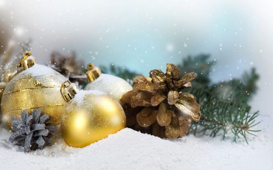 Photo free Christmas balls and cones, snow, spruce branches