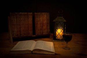 Фото бесплатно книга, свеча, фонарь