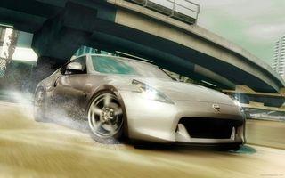 Обои автомобиль, мост, эстакада, дорога, дома, высотки, песок, гонка, скорость, машины