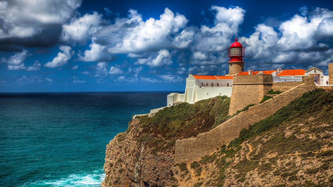 Фото бесплатно маяк, океан, небо, горы, скалы, облака, здание, пейзажи, пейзажи