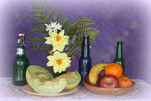 Photo free bottles, flowers, fruit