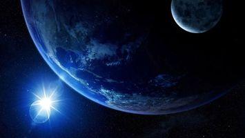 Бесплатные фото новые миры,две планеты,солнце,космос