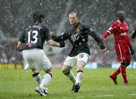 Бесплатные фото футбол,игроки,дождь,поле,спорт