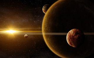 Фото бесплатно планета гигант с кольцами, спутники, яркая звезда, вселенная, космос